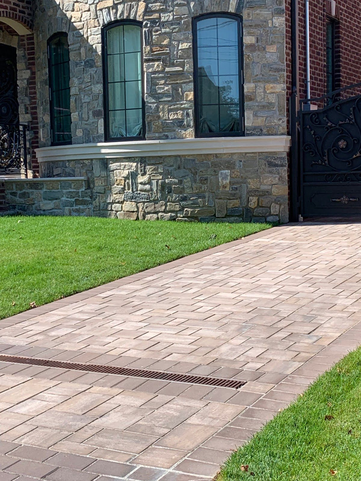 stone wall with long driveway